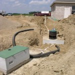 Dosing Tank (in Foreground) and Septic Tank. Both with Risers.